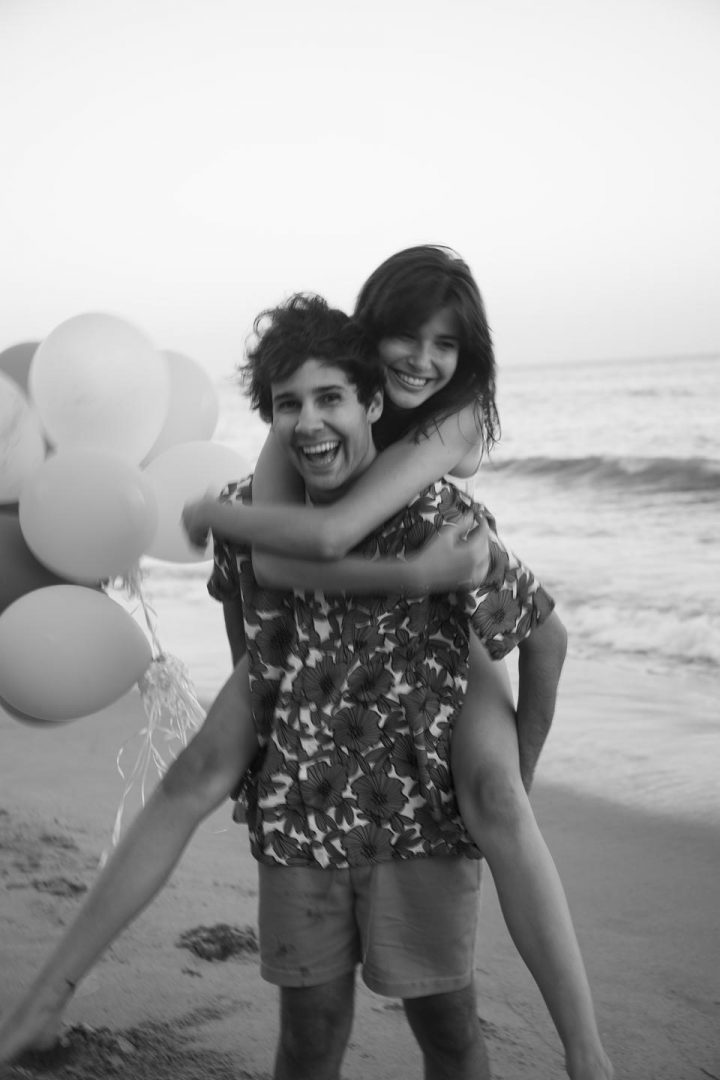 David Dobrik​ and lady friend - giving piggyback ride.#DavidsPerfume COURTESY OF DAVID'S PERFUME/FLOWER SHOP PERFUMES CO.